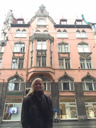 Audrey in front of beautiful Latvian architecture.